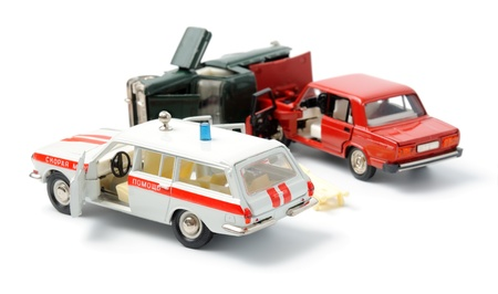 Toy cars in accident on a white background Stock Photo