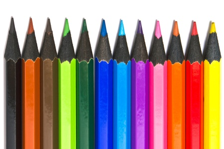 Assortment of coloured pencils on white background photo