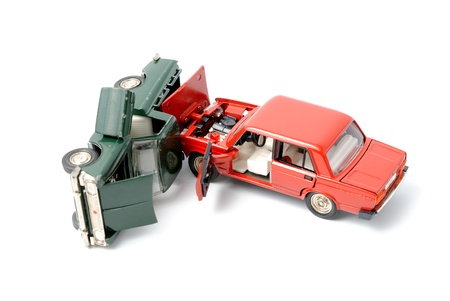 collision: Toy cars in accident on a white background Stock Photo