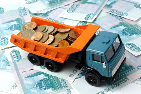 Transportation of small coins for the toy truck. Concept. Stock Photo - 10223486