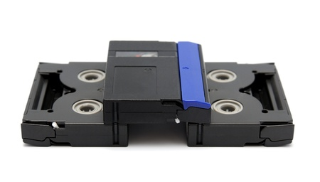 Videocassette standard miniDV isolated on a white background photo