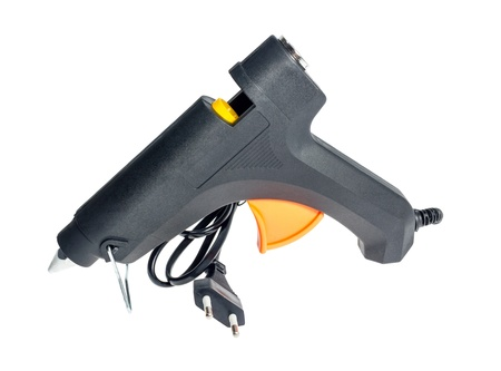 cohere: Electric hot glue gun isolated on a white background.