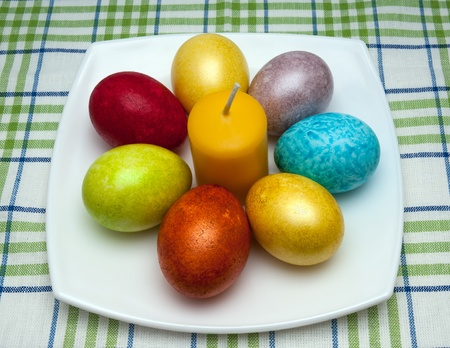 Coloured eggs for easter on white plate photo