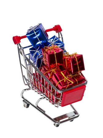Shopping Cart with gift boxes isolated on white background photo
