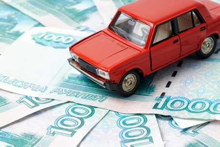 Toy car on the background of banknotes  photo