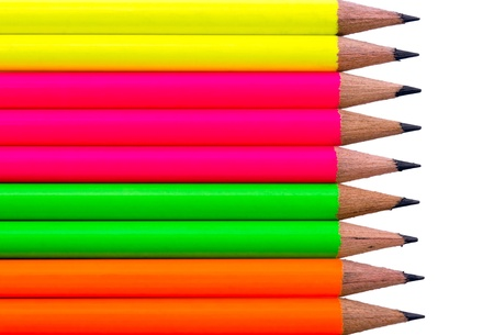 Assortment of fluorescent coloured pencils on white background photo