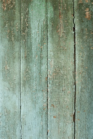 Backgrounds collection - Old, cracked paint on the wooden boards photo