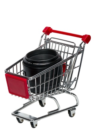Shopping Cart with a camera lens isolated on white background photo