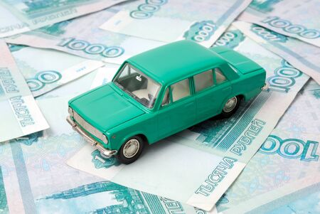 The old car on the background of banknotes. photo