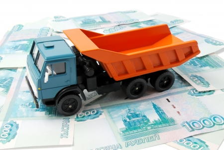 Toy car on the background of banknotes. photo