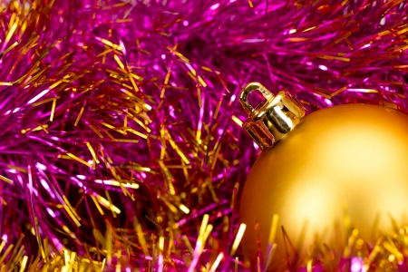 Golden christmas ball on the defocused background of tinsel photo