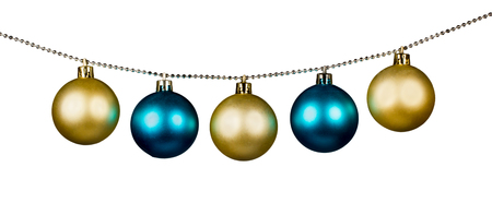 Golden and blue Christmas balls isolated on a white background photo