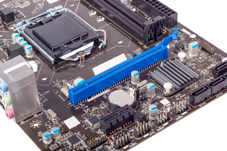 Computer motherboard isolated on white background without CPU cooler Stock Photo