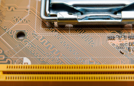dimm: Detail of circuit paths and solderings on a computer mainboard Stock Photo