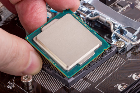computer hardware: Installation of modern processor in CPU socket on the motherboard Stock Photo