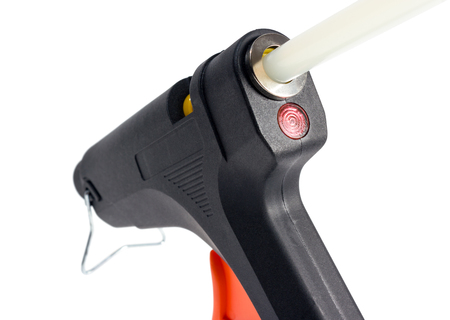 affix: Electric hot glue gun isolated on a white background.
