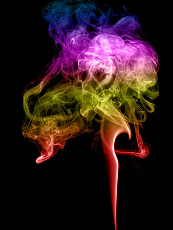 Abstract multicolored smoke on a dark background photo