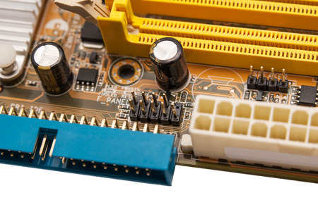 pci card: Electronics components on modern PC computer mainboard Stock Photo
