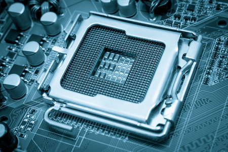 Empty CPU processor socket with pins on motherboard toned blue photo