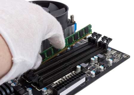 dimm: Installing memory module in DIMM slot on modern PC computer motherboard