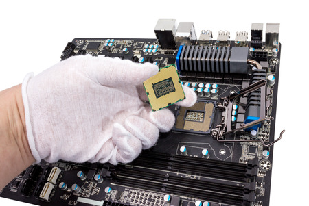 Installation of modern processor in CPU socket on the motherboard photo