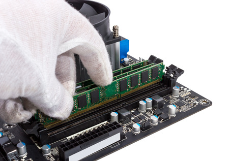 Installing memory module in DIMM slot on modern PC computer motherboard photo