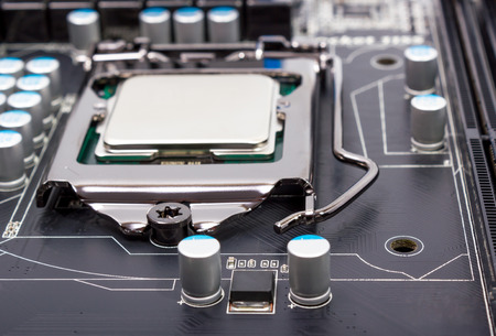 microelectronics: CPU socket on motherboard with installed a processor Stock Photo