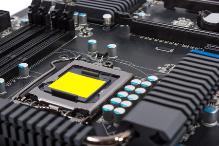 microelectronics: Multiphase power system modern processor with heatsink and the CPU socket Stock Photo