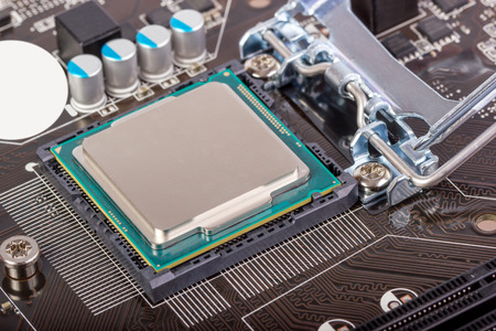 chipset: CPU socket on motherboard with installed a processor Stock Photo