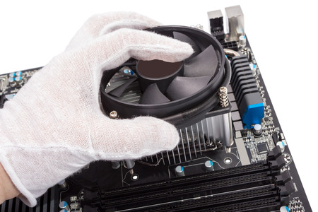 Installing CPU cooler on modern PC computer motherboard Stock Photo