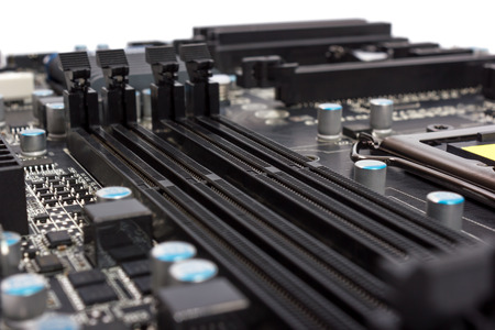 dimm: Electronics components on modern PC computer motherboard with RAM connector slot Stock Photo