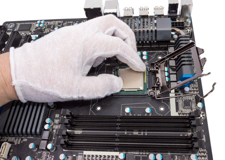 microelectronics: Installation of modern processor in CPU socket on the motherboard Stock Photo
