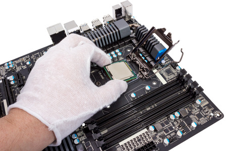 repair computer: Installation of modern processor in CPU socket on the motherboard Stock Photo