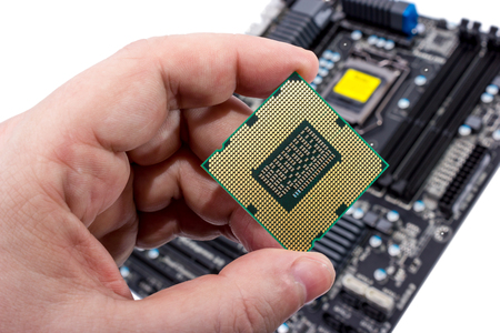 Electronic collection - Installing modern computer processor (CPU) in motherboard Stock Photo