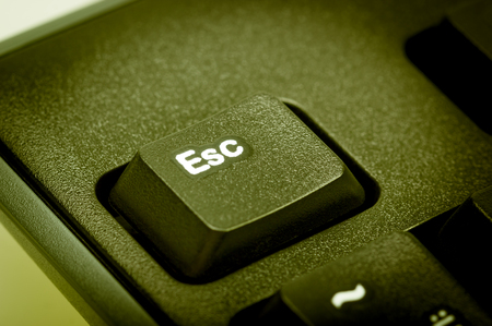 esc: Electronic collection - detail black computer keyboard. The focus on Esc key. Toning is green. Stock Photo