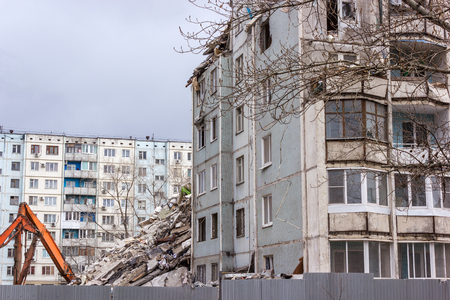 deconstruction: Demolition of buildings in urban environments. House in ruins.
