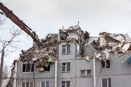 demolished: Demolition of buildings in urban environments. House in ruins.