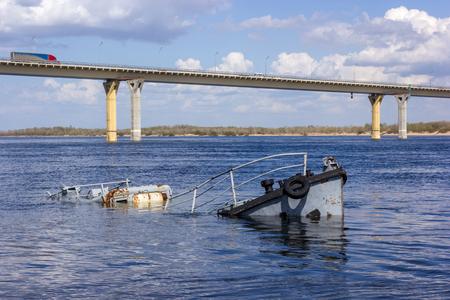 sunken: Rusty sunken boat in a blue river Stock Photo