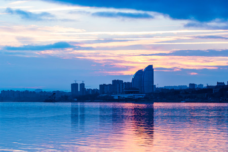 volgograd: Reflection of urban architecture in the river at sunset