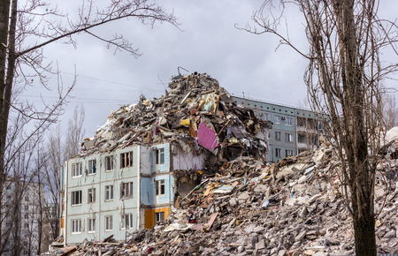 dismantling: Demolition of buildings in urban environments. House in ruins.
