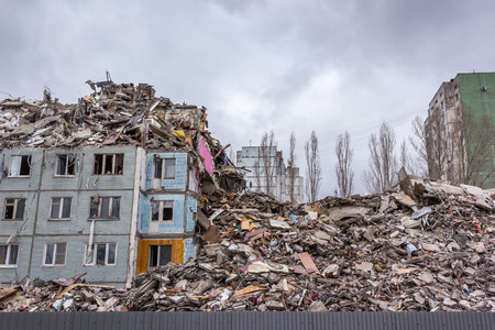 Demolition of buildings in urban environments. House in ruins.