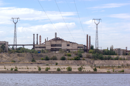 ironworks: Panoramic view of ironworks located on the river coastline. Industrial landscape. Stock Photo