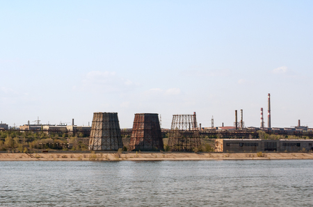 ironworks: Ironworks located on the river coastline. Industrial landscape.