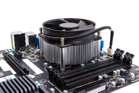 Computer motherboard isolated on white background with CPU cooler