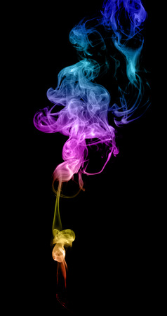 Abstract multicolored smoke on a dark background Banco de Imagens