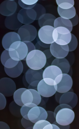 Blurred christmas lights background. Abstract light bokeh. 免版税图像