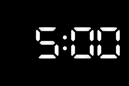 Real white led digital clock on a black background showing time 5:00
