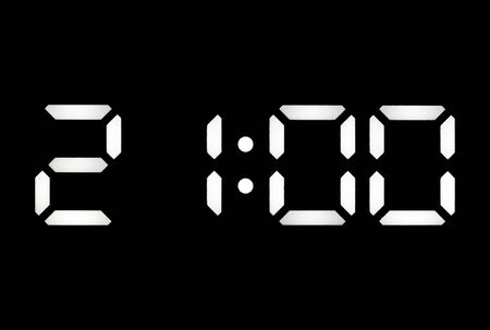 Real white led digital clock on a black background showing time 21:00