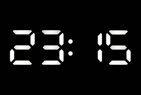 Real white led digital clock on a black background showing time 23:15 Imagens