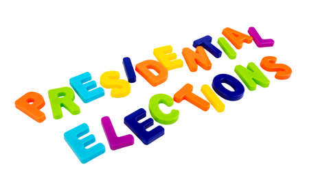 Text PRESIDENTIAL ELECTIONS written in plastic letters on a white background. Concept for the electoral campaign.